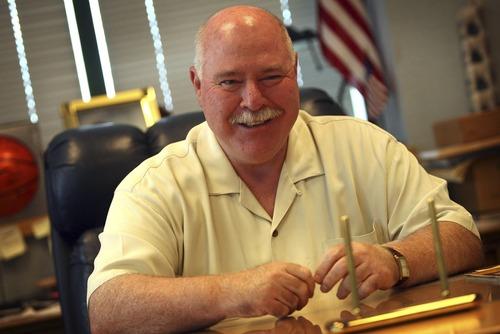 Sandy Mayor Tom Dolan in his office at city hall. Ryan Galbraith/photograph 08.16.06