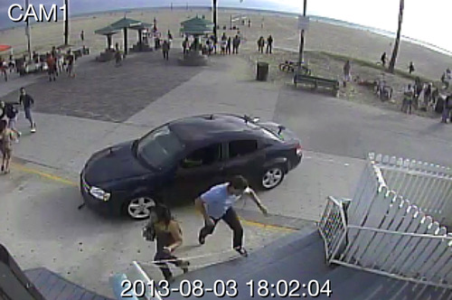 In this still frame made from security camera footage from Snapchat, Inc. headquarters, pedestrians scatter as a car drives through a packed afternoon crowd along the Venice Beach boardwalk in Los Angeles, Saturday, Aug. 3, 2013. A driver plowed into crowds at the Venice Beach boardwalk in a seemingly intentional hit-and-run that killed a woman and injured 11 others. (AP Photo/Snapchat Inc.)