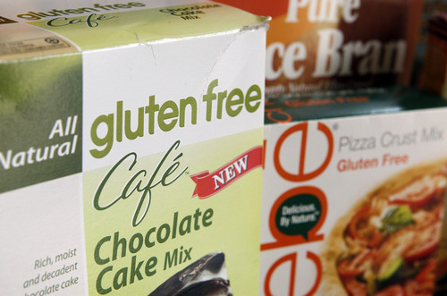 """A variety of foods labeled Gluten Free are displayed in Frederick, Md., Friday, Aug. 2, 2013. Consumers are going to know exactly what they are getting when they buy foods labeled """"gluten free."""" The Food and Drug Administration (FDA) is at last defining what a """"gluten free"""" label on a food package really means after more than six years of consideration. Until now, manufacturers have been able to use their own discretion as to how much gluten they include. Under an FDA rule announced Friday, products labeled """"gluten free"""" still won't have to be technically free of wheat, rye and barley and their derivatives. But they almost will: """"Gluten-free"""" products will have to contain less than 20 parts per million of gluten. (AP Photo/Jon Elswick)"""