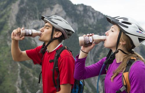 BYU students Marcos Escalona and Bella Torgers enjoy BYU Creamery chocolate milk on Squaw Peak in July 2012. (Courtesy of BYU)