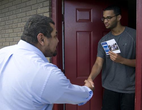 Rick Egan    The Salt Lake Tribune  West Jordan mayoral candidate Daniel Argueta shakes hands with Bronzell Miller as he goes door to door, handing out fliers.
