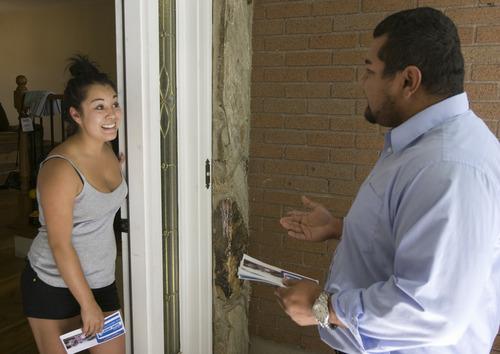 Rick Egan    The Salt Lake Tribune  West Jordan mayoral candidate Daniel Argueta talks to Kylee Rodriguez as he goes door to door, handing out fliers, Wednesday, July 31, 2013.