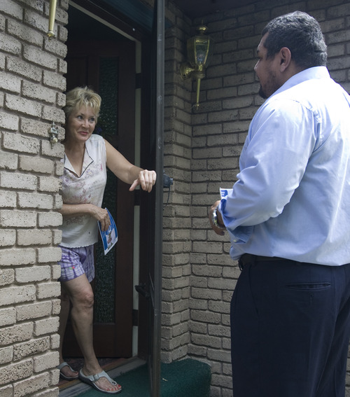 Rick Egan    The Salt Lake Tribune  Daniel Argueta, a cofounder of the Brown Berets, has moved from marching and organizing as an activist to running for public office -- West Jordan mayor. On a recent weekday he chatted with Gloria Smith as he goes door to door, handing out fliers.