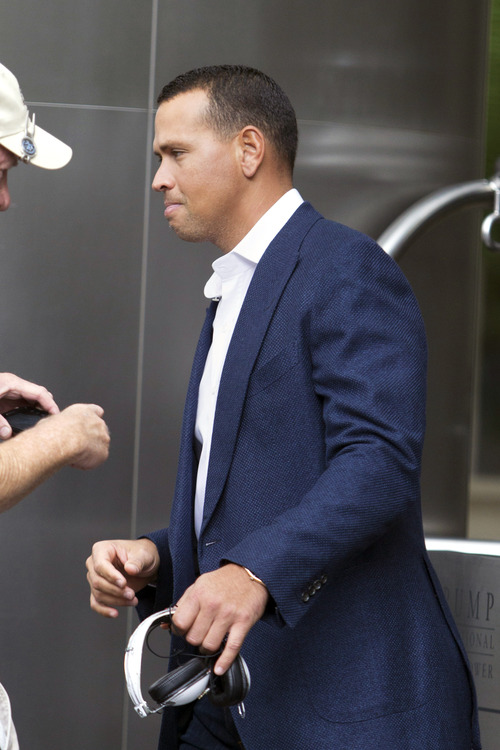 New York Yankees third baseman Alex Rodriguez leaves the Trump International Hotel in Chicago, Monday, Aug. 5, 2013. Rodriguez was suspended through 2014 and All-Stars Nelson Cruz, Jhonny Peralta and Everth Cabrera were banned 50 games apiece Monday when Major League Baseball disciplined 13 players in a drug case the most sweeping punishment since the Black Sox scandal nearly a century ago. (AP Photo/Scott Eisen)