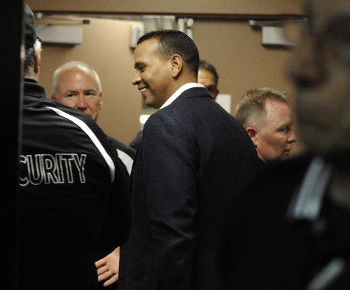 New York Yankees' Alex Rodriguez arrives at the clubhouse at U.S. Cellular Field before an MLB baseball game between the Chicago White Sox and New York Yankees in Chicago, Monday, Aug. 5, 2013. (AP Photo/Paul Beaty)