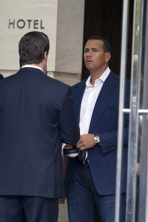 New York Yankees third baseman Alex Rodriguez, right, leaves the Trump International Hotel in Chicago, Monday, Aug. 5, 2013. Rodriguez was suspended through 2014 and All-Stars Nelson Cruz, Jhonny Peralta and Everth Cabrera were banned 50 games apiece Monday when Major League Baseball disciplined 13 players in a drug case the most sweeping punishment since the Black Sox scandal nearly a century ago. (AP Photo/Scott Eisen)