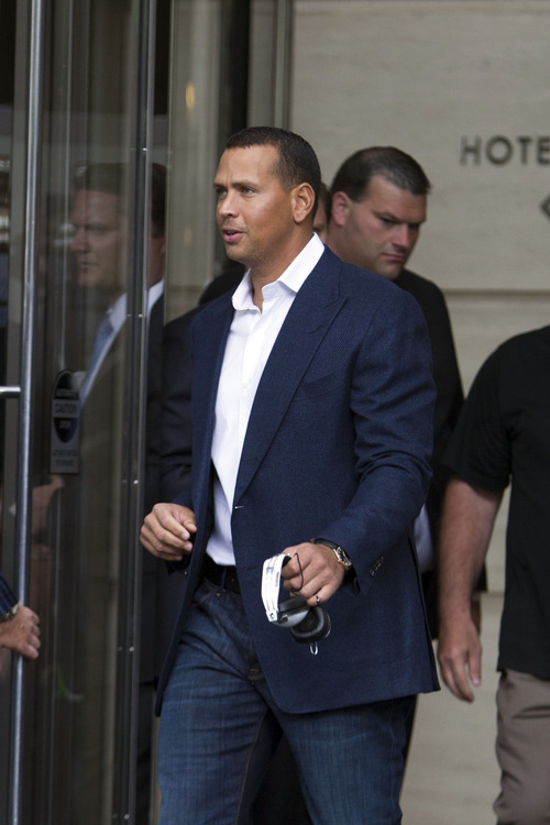 New York Yankees third baseman Alex Rodriguez leaves the Trump International Hotel in Chicago, Monday, Aug. 5, 2013. Rodriguez was suspended through 2014 and All-Stars Nelson Cruz, Jhonny Peralta and Everth Cabrera were banned 50 games apiece Monday when Major League Baseball disciplined 13 players. It was the most sweeping punishment since the Black Sox scandal nearly a century ago. (AP Photo/Scott Eisen)