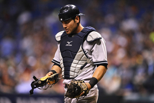 FILE - In this April 24, 2013 file photo, New York Yankees catcher Francisco Cervelli  reacts during the fourth inning of a baseball game against the Tampa Bay Rays in St. Petersburg, Fla. Major League Baseball has told the union which players it intends to suspend in its drug investigation and which ones will receive lengthier penalties for their roles in the Biogenesis case. (AP Photo/Brian Blanco, File)