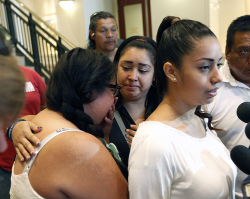 Al Hartmann  |  The Salt Lake Tribune Ana Portillo, right, speaks to the media at Fourth District Court in Salt Lake City Monday August 5 as her sisters , Valeria, and Johana Portillo comfort each other after an unidentified juvenile plead guilty in the death of their father Ricardo Portillo.