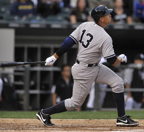 New York Yankees' Alex Rodriguez watches his single during the second inning of a baseball game against the Chicago White Sox in Chicago, Monday, Aug. 5, 2013. (AP Photo/Paul Beaty)