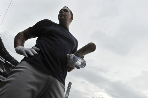New York Yankees' Alex Rodriguez walks onto U.S. Cellular Field before a baseball game against the Chicago White Sox in Chicago, Monday, Aug. 5, 2013. (AP Photo/Paul Beaty)