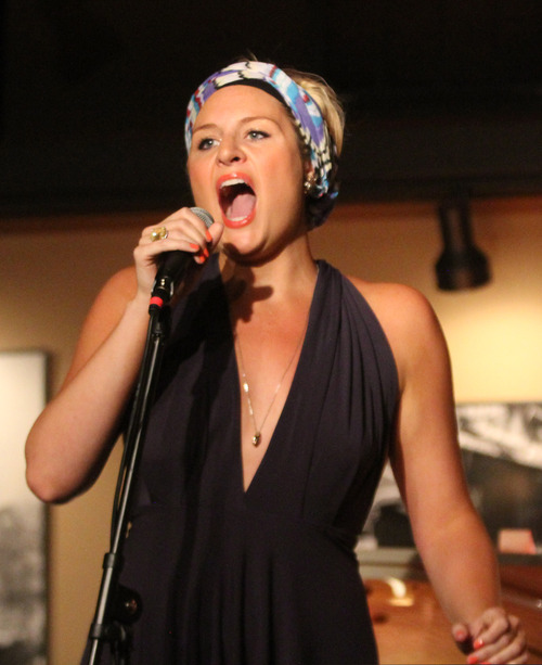 "Rick Egan  | The Salt Lake Tribune   Cate Cozzens sings ""I Wanna Get Married"" during the R.E.A.C.H. Cabaret at the Grind Coffee House in Cedar City, Friday, July 19, 2013."