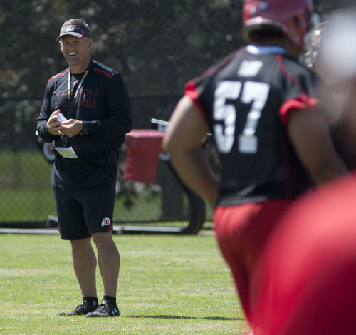 Steve Griffin | The Salt Lake Tribune Utah coach Kyle Whittingham is happy to see position battles breaking out all over presason camp. It signals better depth for the Utes in 2013.