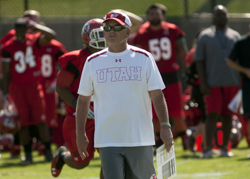 Steve Griffin | The Salt Lake Tribune Utah co-offensive coordinator, Dennis Erickson , watches a play during football practice on the baseball field on the University of Utah campus in Salt Lake City, Utah Monday August 5, 2013.