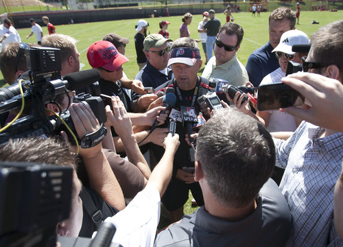 Steve Griffin | The Salt Lake Tribune Utah head coach Kyle Whittingham talks with the media following football practice on the baseball field on the University of Utah campus in Salt Lake City, Utah Monday August 5, 2013.