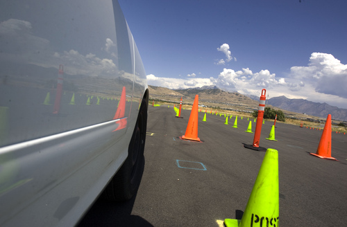 Keith Johnson | The Salt Lake Tribune  Nate Davis maneuvers a vehicle through an obstacle course at the Department of Public Safety Emergency Vehicle Operations driving range in Lehi on Wednesday, Aug. 7, 2013. Nate and two other drivers deprived themselves of sleep for 30 hours before demonstrating the potential effects of drowsy driving. It was coordinated by Sleep Smart. Drive Smart., an alliance of organizations dedicated to educating the public about the potentially fatal consequences of driving tired.