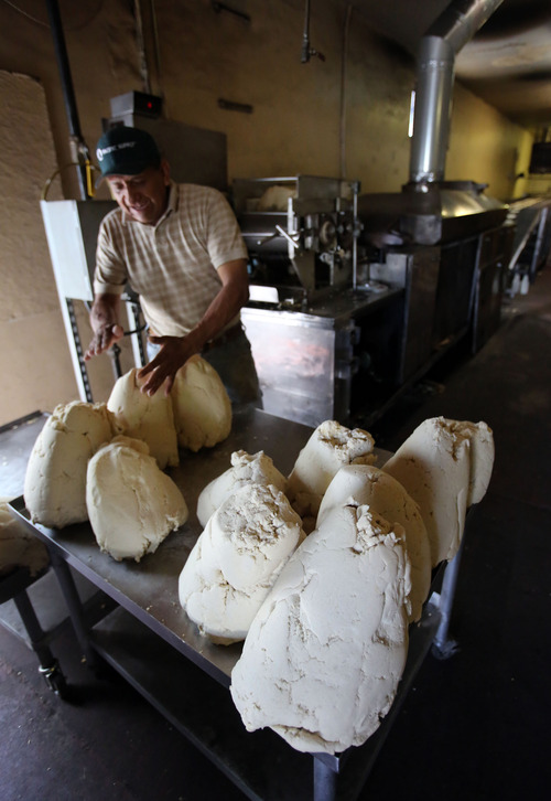 Francisco Kjolseth  |  The Salt Lake Tribune José Antonio Aranda feeds corn masa into a machine that makes tortillas at the Acapulco Mexican market along Indiana on the west side of Salt Lake City. The market caters to many ethnic cultures in the area, and the tortillas are the biggest part of its business.