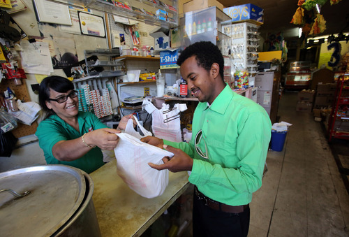Francisco Kjolseth  |  The Salt Lake Tribune Mary Hernandez, owner of Acapulco Mexican market, sells tortillas to one of her regular customers, Abdul Hashi, 18, of Ethiopia. His family of eight uses the tortillas to make sambusas, one of the staples in their diet. Hernandez, who has run her business since 1995, caters to many ethnic cultures in her neighborhood along Indiana Avenue in west Salt Lake City.