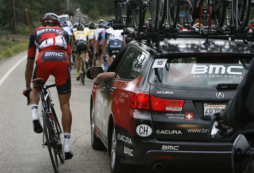 Francisco Kjolseth  |  The Salt Lake Tribune Greg Van Avarmaet of team BMC drops back to speak with the team car as the Tour of Utah kicks off in southern Utah with 126 professional cyclists taking on 112 miles for stage one from Brian Head to Cedar City on Tuesday, August 6, 2013.