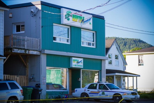 "A Royal Canadian Mounted Police cruiser sits outside the Reptile Ocean exotic pet store in Campbellton, New Brunswick, Canada, on Tuesday, Aug.  6, 2013.  Autopsies will be performed Tuesday on two young boys who were strangled in their sleep by a large 4.3 meter African rock python that escaped from the pet store and slithered through a ventilation system and crashed down from the ceiling into the living room of an apartment upstairs from the pet store.  The brothers, ages 5 and 7, were visiting the apartment of a friend above Reptile Ocean Inc. said Royal Canadian Mounted Police Const. Julie Rogers-Marsh.  The store owner, Jean-Claude Savoie, said he didn't hear a sound during the incident and discovered the ""horrific scene"" when he went into his living room, where the two boys had been sleeping, on Monday morning. Savoie said the snake fell through the living room from the ceiling.  (AP Photo/The Canadian Press, John LeBlanc)"