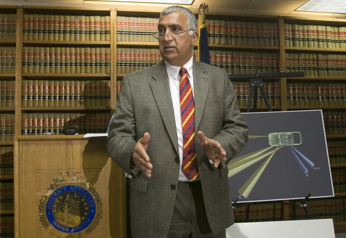 Rick Egan  | The Salt Lake Tribune  Salt Lake County District Attorney Sim Gill discusses the findings of the investigation into the Danielle Willard fatal shooting, Thursday, August 8, 2013. Mike Powell, West Valley Police is on the right.