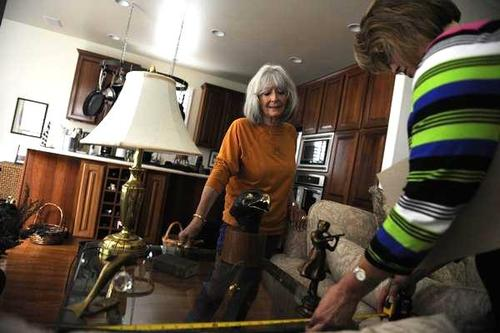 Fern Bechtel, left, works with personal moving consultant Beth Brandenburg of Wind Crest in Littleton, Colo. Bechtel is downsizing from her home of eight years to a smaller one-bedroom home. (Photos by Erin Hull, The Denver Post)