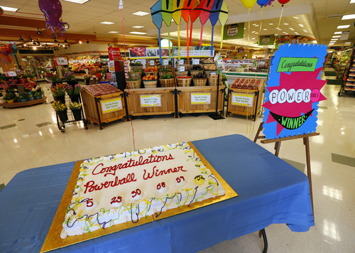 A cake celebrating a Powerball winner sits on a table near the entrance of Stop & Shop in South Brunswick, N.J., Thursday, Aug. 8, 2013. One of the three winning Powerball tickets was sold at this store, while the other two are in southern New Jersey and Minnesota. The jackpot is $448 million, the third largest ever. (AP Photo/Rich Schultz)