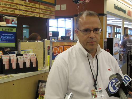 Phil Weber, director of the Acme Markets store in Little Egg Harbor, N.J, speaks with reporters on Thursday, Aug. 8, 2013. His store sold one of three winning tickets for Wednesday's  Powerball drawing with a jackpot of $448 million. (AP Photo/Geoff Mulvihill)
