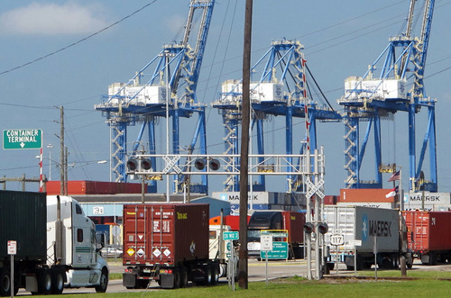 In this July 25, 2013, photo, Trucks move into the container terminal at the Port of Wilmington in Wilmington, N.C. The government reports how much wholesale businesses adjusted their stockpiles in June and how much they collected in sales on Friday, Aug. 9, 2013. (AP Photo/Bruce Smith)
