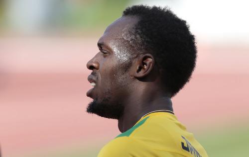 Jamaica's Usain Bolt attends a Team Jamaica training session ahead of IAAF Athletics World championships at the Luzhniki stadium in Moscow, Russia, on Thursday, Aug. 8, 2013. (AP Photo/Ivan Sekretarev)