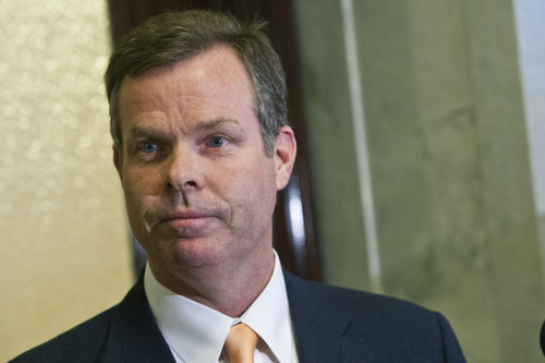 Chris Detrick  |  The Salt Lake Tribune Attorney General John Swallow talks to members of the media outside of his office at the Utah State Capitol Wednesday June 19, 2013.