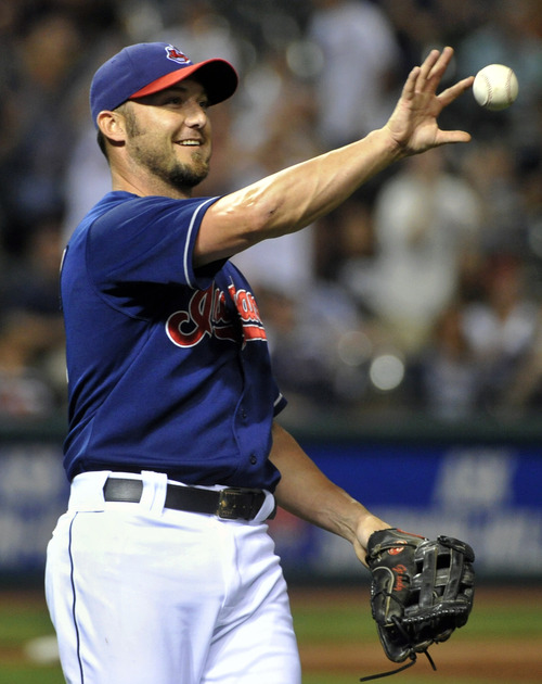 Cleveland Indians right fielder, Ryan Raburn fills in as a relief pitcher against the Detroit Tigers during the ninth inning of a baseball game at Progressive Field in Cleveland, Thursday, Aug. 8, 2013. Raburn retired the side in order but the Tigers won the game 10-3. (AP Photo/Phil Long)