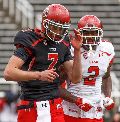 Trent Nelson     The Salt Lake Tribune Quarterback Travis Wilson and Kenneth Scott celebrate a touchdown during the University of Utah's Red-White Spring football game, Saturday, April 20, 2013, in Salt Lake City.