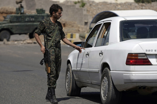 A Yemeni soldier checks a car at a checkpoint on a street leading to the U.S. and British embassies in Sanaa, Yemen, Saturday, Aug. 10, 2013. Eighteen U.S. diplomatic outposts closed because of a terrorist threat will reopen Sunday, but the U.S. Embassy in Yemen will remain closed due to U.S. State Department ongoing concerns about potential terrorist attacks by al-Qaida in the Arabian Peninsula. (AP Photo/Hani Mohammed)