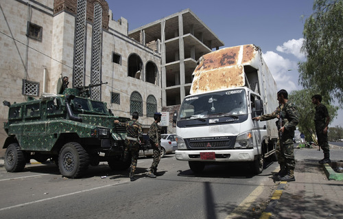 Yemeni soldiers check a truck at a checkpoint on a street leading to the U.S. and British embassies in Sanaa, Yemen, Saturday, Aug. 10, 2013. Eighteen U.S. diplomatic outposts closed because of a terrorist threat will reopen Sunday, but the U.S. Embassy in Yemen will remain closed due to U.S. State Department ongoing concerns about potential terrorist attacks by al-Qaida in the Arabian Peninsula. (AP Photo/Hani Mohammed)