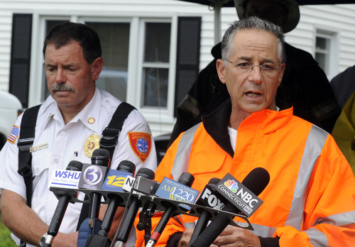 East Haven Mayor Joseph Maturo, right, speaks with the media as East Haven fire Chief Douglas Jackson listens, left, at the scene of a small plane crash in East Haven, Conn., on Friday, Aug. 9, 2013.  (AP Photo/Fred Beckham)