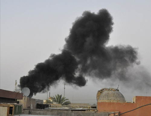 Black smoke from a car bomb attack is seen in Baghdad, Iraq, Saturday, Aug. 10, 2013. A wave of car bombings targeted cafes and markets around the Iraqi capital of Baghdad as people celebrate the end of the Muslim holy month of Ramadan, killing and wounding scores of people, officials said. (AP Photo)