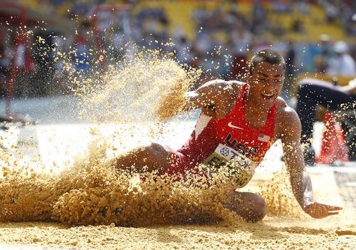 United States' Ashton Eaton competes in the men's long jump of the decathlon at the World Athletics Championships in the Luzhniki stadium in Moscow, Russia, Saturday, Aug. 10, 2013. (AP Photo/Matt Dunham)