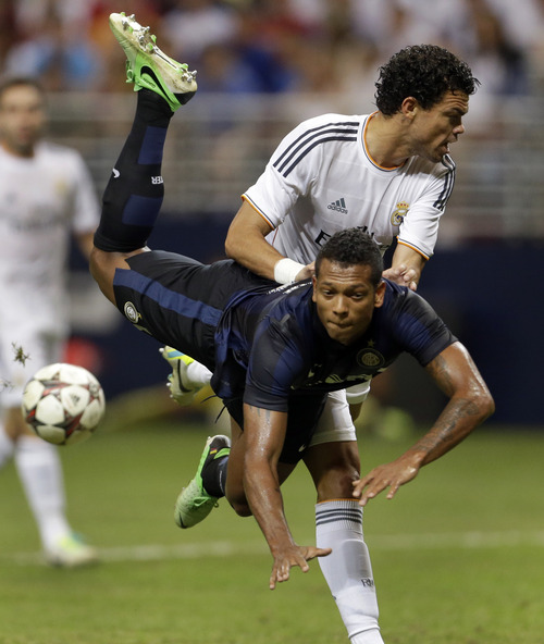 Inter Milan's Fredy Guarin, front, collides with Real Madrid's Pepe during the second half of an exhibition soccer match on Saturday, Aug. 10, 2013, at the Edward Jones Dome in St. Louis. Real Madrid won 3-0. (AP Photo/Jeff Roberson)