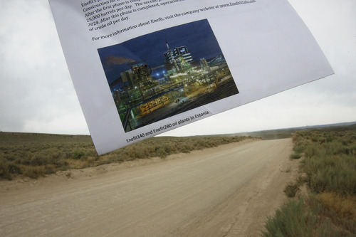 Scott Sommerdorf   |  The Salt Lake Tribune A page from an Enefit oil company brochure shows a plant in Estonia that will be like the proposed processing plant they plan to build on this portion of their 320 acre piece of property in the north end of their private holdings in Uintah County, Wednesday, August 7, 2013.