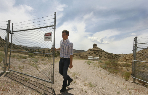 Scott Sommerdorf   |  The Salt Lake Tribune Enefit mining engineer Ben France opens one of the locked gates to their White River mine on BLM land in eastern Uintah county, Wednesday, August 7, 2013. The mine was developed in the '80s and abandoned in 1985 after the oil price crash. The Estonian state-owned company Enefit American Oil seeks to develop Utah oil shale. Enefit has already excavated tons of ore that has been shipped to Germany for testing.