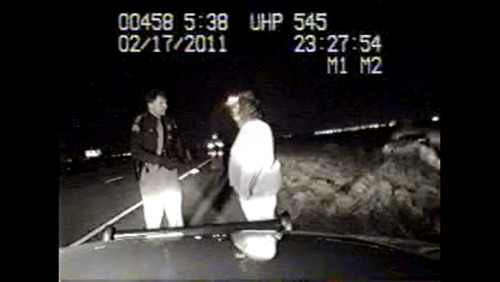 Courtesy photo In this screengrab from dashcam video, UHP trooper Bryan Gardner questions the girlfriend of Moses Gai Geng. Gardner's testimony in a June trial has come under scrutiny as the video contradicted Gardner's statements.
