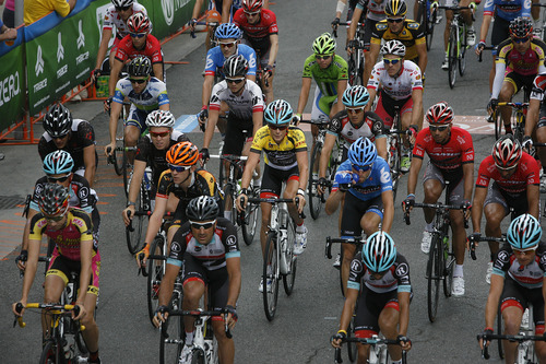 Scott Sommerdorf   |  The Salt Lake Tribune Christopher Horner, in the leader's yellow jersey, center, starts Stage 6 of the Tour of Utah in the middle of the pack as it winds through Park City's Main Street, Sunday, August 11, 2013.