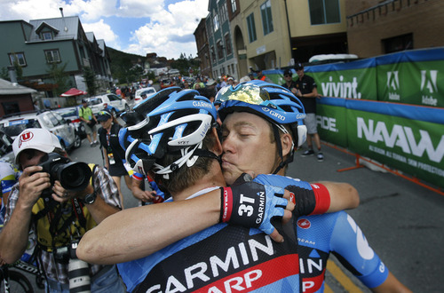 Scott Sommerdorf   |  The Salt Lake Tribune Tour of Utah winner Thomas Danielson, right, of Team Garmin-Sharp, kisses team mate Peter Stetina after he won the overall Tour of Utah title with a third place finish in Stage 6, Sunday, August 11, 2013.