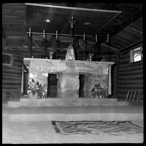 Salt Lake Tribune archive  The Common Room, also used in church services, at St. Christopher's Mission in Bluff, Utah, 1950. St. Christopher's Episcopal Mission was established in 1943 when H. Baxter Liebler, an Episcopal priest from Old Greenwich, Conn., came to Bluff to establish a mission among the Navajo people. St. Christopher's is named after the patron saint of travelers. When Father Liebler arrived in Bluff, there were no missions, schools, or medical/hospital facilities for the Navajo living in this remote Utah section of the reservation. Before arriving in southeast Utah, Father  Liebler studied the Navajo language to make his message comprehensible to the Dineh and compatible with their understanding of harmony.  He participated in Navajo ceremonies and wore his hair in the traditional Navajo style - long, pulled back and wrapped. A year after the mission was established, a school was started which became the only school for the 1,500 Navajo living in the central part of the Utah strip of the Navajo Reservation. A hospital/clinic building was completed in 1956. An estimated 500 babies were born in the clinic during the years it was in operation.