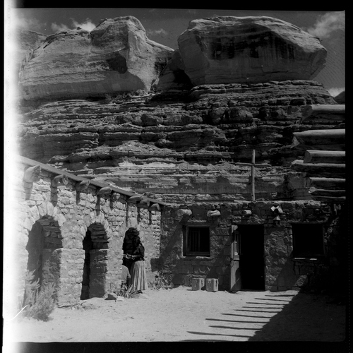 Salt Lake Tribune archive  St. Christopher's Mission in Bluff, Utah, 1950. St. Christopher's Episcopal Mission was established in 1943 when H. Baxter Liebler, an Episcopal priest from Old Greenwich, Conn., came to Bluff to establish a mission among the Navajo people. St. Christopher's is named after the patron saint of travelers. When Father Liebler arrived in Bluff, there were no missions, schools, or medical/hospital facilities for the Navajo living in this remote Utah section of the reservation. Before arriving in southeast Utah, Father  Liebler studied the Navajo language to make his message comprehensible to the Dineh and compatible with their understanding of harmony. He participated in Navajo ceremonies and wore his hair in the traditional Navajo style - long, pulled back and wrapped. A year after the mission was established, a school was started which became the only school for the 1,500 Navajo living in the central part of the Utah strip of the Navajo Reservation. A hospital/clinic building was completed in 1956.  An estimated 500 babies were born in the clinic during the years it was in operation.