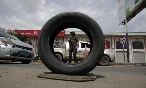 A Yemeni police trooper stands guard while manning a checkpoint amid an increase in security following an announcement last week by Yemeni authorities that they had discovered an al-Qaida plot to target foreign embassies and international shipping in the Red Sea, in Sanaa, Yemen, Monday, Aug. 12, 2013. The leader of the Yemen-based al-Qaida offshoot vowed in a message posted Monday to free fellow militants from prisons and urged jailed fighters to remain faithful to the terror group's ideology. (AP Photo/Hani Mohammed)