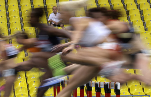 Athletes compete in the 110-meter hurdles of the heptathlon at the World Athletics Championships in the Luzhniki stadium in Moscow, Russia, Monday, Aug. 12, 2013. (AP Photo/David J. Phillip)