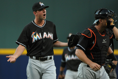 Miami Marlins starting pitcher Jacob Turner, left, reacts after he was warned for hitting Atlanta Braves batter Dan Uggla after giving up two home runs in the first inning of a baseball game at Turner Field, Friday, Aug. 9, 2013, in Atlanta. (AP Photo/David Tulis)