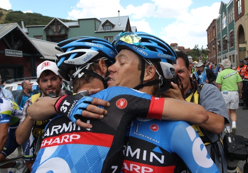 Thomas Danielson, right, of team Garmin-Sharp, hugs teammate Peter Stetina, left, after winning the overall Tour of Utah cycling race during Stage 6, Sunday, Aug. 11, 2013, in Park City, Utah. Danielson came in third place during the stage. (AP Photo/Rick Bowmer)